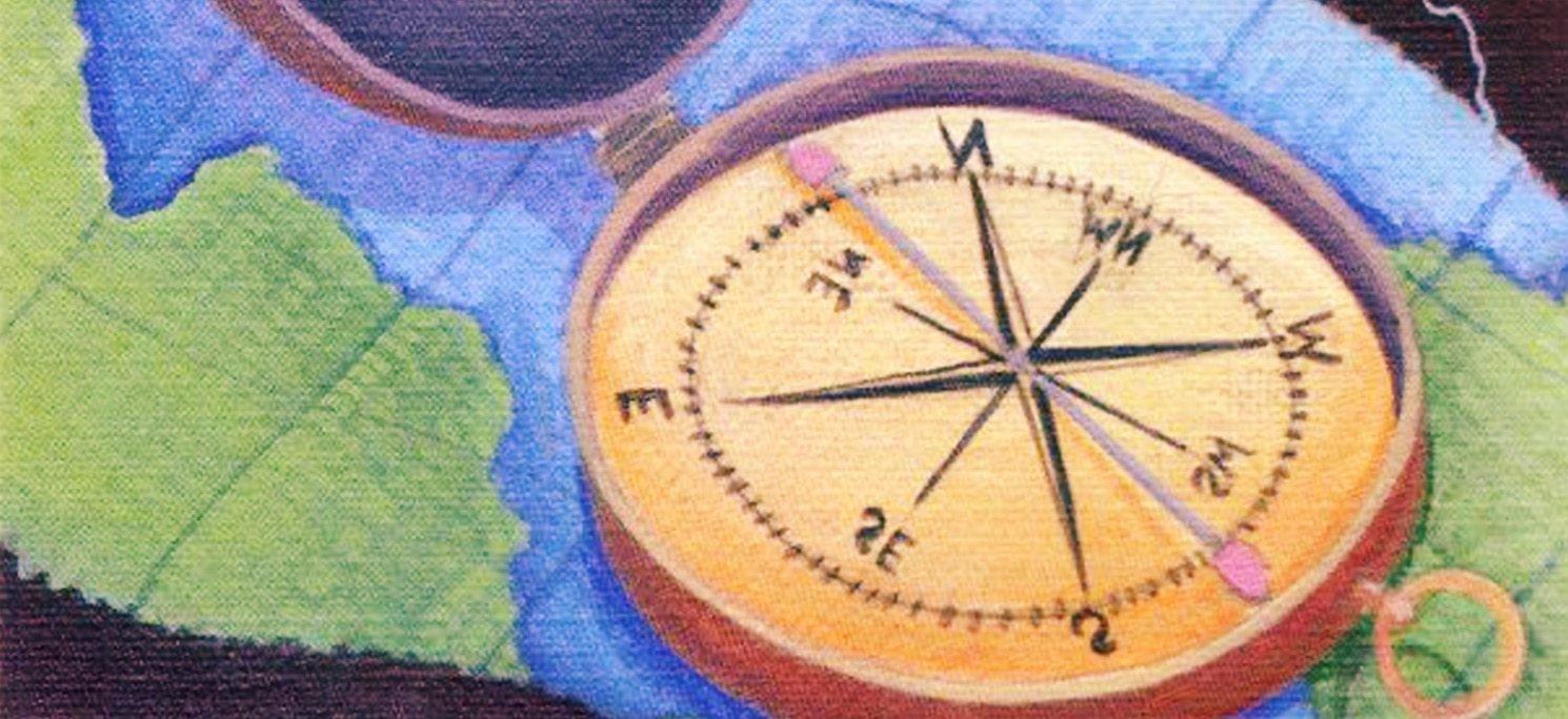 Illustrazione di una bussola appoggiata su di una carta geografica